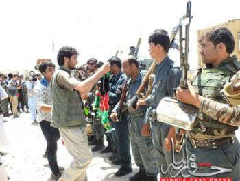 Giving flowers to soldiers fighting at front lines in Baghlan
