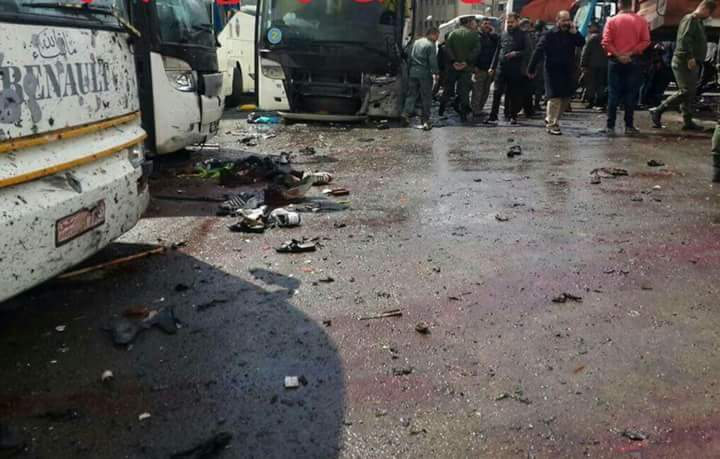 At least 12 people dead in twin blasts in Syria's Damascus